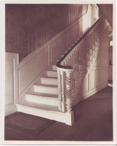 First-floor entryway with carved staircase