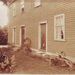 Slave Quarters, north facade with wagon wheel